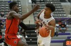 Moses Moody dribbles around a defender during an AAU game Friday, April 12, 2019, at Bulldog Arena in Fayetteville.