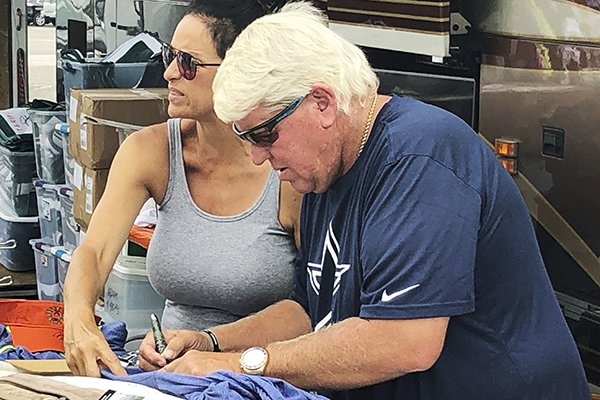 John Daly has signs autographs outside a Hooters on Washington Road during the third round for the Masters golf tournament Saturday, April 13, 2019, in Augusta, Ga. (AP Photo/Paul Newberry)