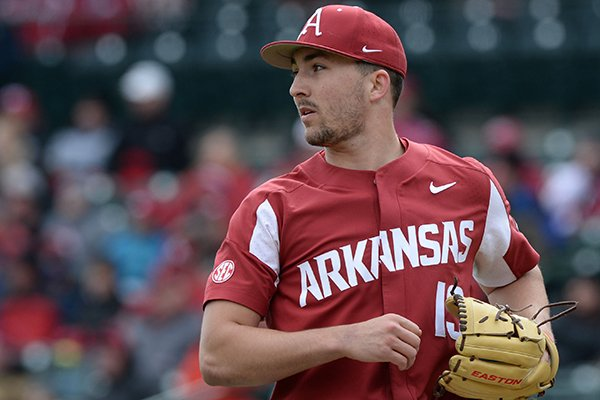 Arkansas starter Connor Noland backs up third as Ole Miss scores a run Saturday, March 30, 2019, on a single by third baseman Tyler Keenan during the third inning at Baum-Walker Stadium in Fayetteville.