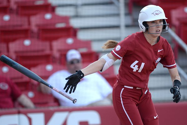 Arkansas designated hitter Danielle Gibson tosses her bat as she heads to first against Wichita State Wednesday, April 10, 2019, during the fourth inning at Bogle Park in Fayetteville.