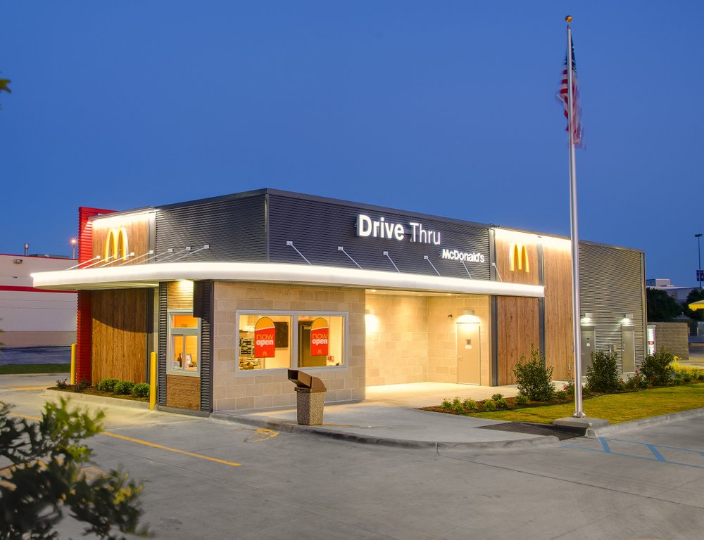 A McDonald's press photo shows a similar color scheme and design to the new Magnolia McDonald's.   Note: This is not an exact mockup of the new location. It is a Denton, Texas, drive-thru only restaurant. Magnolia's site will be much larger and contain more features. The color scheme and design are similar to give readers a visual idea of the new building.