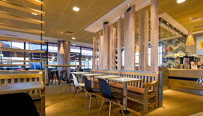 """A McDonald's press photo shows the """"wood and stone"""" decor that Magnolia's rebuilt McDonald's will feature."""