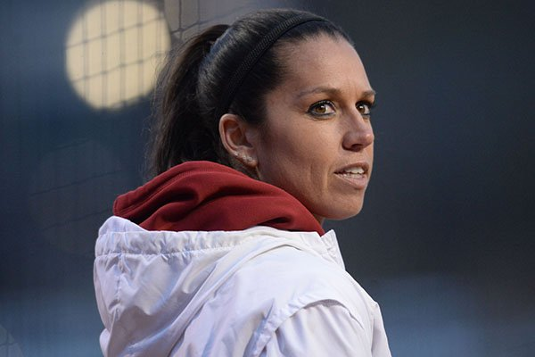 Arkansas coach Courtney Deifel watches from the third-base coaches box against Southeast Missouri Thursday, Feb. 21, 2019, during the fourth inning at Bogle Park on the university campus in Fayetteville.