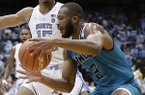UNC Wilmington's Jeantal Cylla (2) dribbles during the second half of an NCAA college basketball game in Chapel Hill, N.C., Wednesday, Dec. 5, 2018. North Carolina won 97-69. (AP Photo/Gerry Broome)