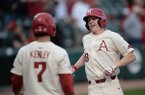 Arkansas right fielder Heston Kjerstad is congratulated at the plate Tuesday, April 23, 2019, by third baseman Jack Kenley after Kjerstad hit a solo home run during the third inning at Baum-Walker Stadium in Fayetteville.