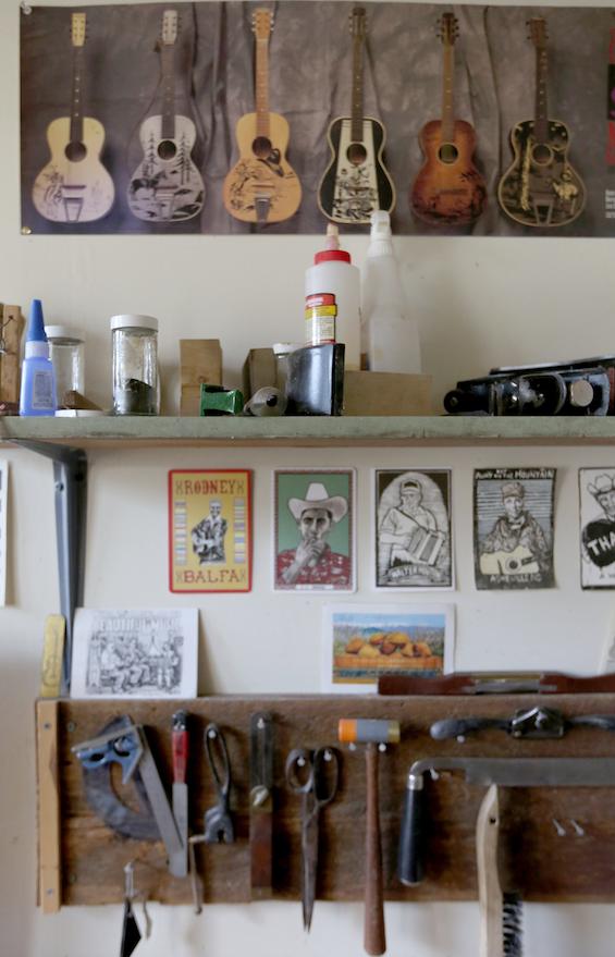 Aviva Steigmeyer's artwork and tools are on display at her small Preservation Guitar Company shop. (NWA Democrat-Gazette/DAVID GOTTSCHALK)