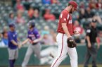 Arkansas closer Matt Cronin reacts Wednesday, April 24, 2019, as Northwestern State right fielder Tyler Smith rounds the bases after hitting a two-run home run during the ninth inning at Baum-Walker Stadium in Fayetteville. Smith finished with three home runs and 7 RBI in a 10-7 win over Arkansas.