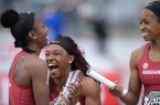Arkansas runners Janeek Brown (left), Kiara Parker (center) and Kethlin Campbell celebrate after winning the 400-meter relay during the National Relay Championships on Saturday, April 27, 2019, in Fayetteville.