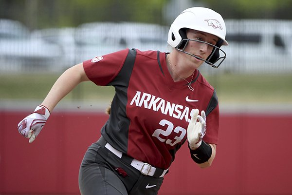 Arkansas baserunner Hannah McEwen rounds third base to score a run against Arkansas-Pine Bluff during an NCAA softball game on Tuesday, April 16, 2019 in Fayetteville. (AP Photo/Michael Woods)