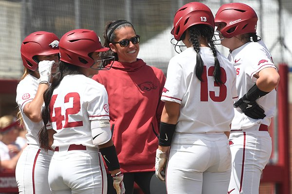 Arkansas coach Courtney Deifel talks to players during a game against Auburn on Sunday, May 5, 2019, in Fayetteville.