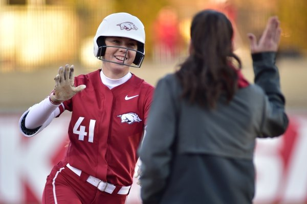 Arkansas sophomore Danielle Gibson rounds third base after hitting one of her four home runs against SIU-Edwardsville on Feb. 23. The Razorbacks won 15-3 in five innings.