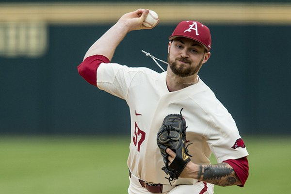 Arkansas pitcher Cody Scroggins throws during a game against LSU on Saturday, May 11, 2019, in Fayetteville.