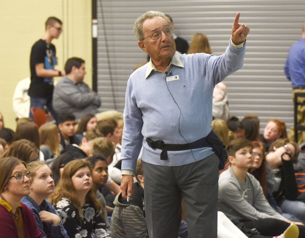 Pieter Kohnstam talks to students at Fulbright Junior High School in Bentonville on Nov. 14 about his experiences fleeing Germany during the Holocaust. (NWA Democrat-Gazette/FLIP PUTTHOFF)