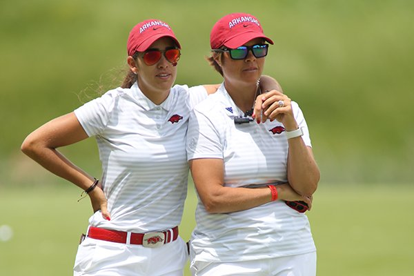 Arkansas senior Maria Fassi and Arkansas head coach Shauna Taylor watch during the NCAA Women's Golf Championships on Monday, May 20, 2019, at Blessings Golf Club in Fayetteville.