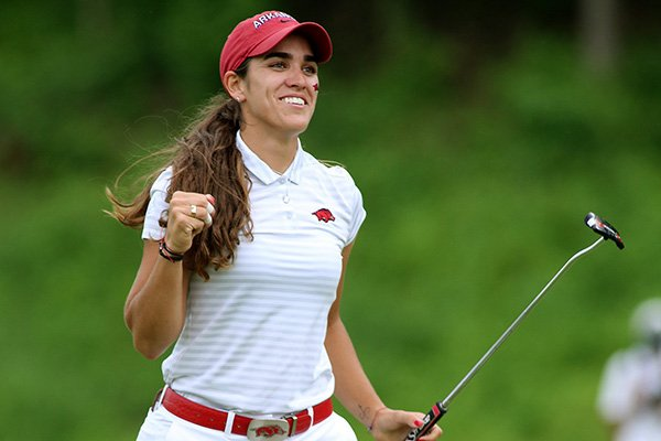 Arkansas golfer Maria Fassi celebrates on the 18th green during the NCAA Women's Golf Championships on Monday, May 20, 2019, at Blessings Golf Club in Fayetteville. Fassi shot a 5-under 68 in the final round of stroke play to earn the individual national title - the Razorbacks' first since Stacy Lewis in 2007.