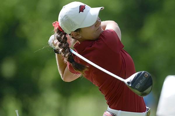 Kaylee Benton of Arkansas watches her tee shot Tuesday, May 21, 2019, on the 15th tee box during her match with Jennifer Kupcho of Wake Forest in the Women's NCAA Golf Championship at Blessings Golf Club in Fayetteville.