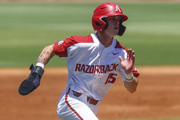 Arkansas' Casey Martin runs home to score on a RBI single from Arkansas' Dominic Fletcher during the first inning of a Southeastern Conference tournament game against Ole Miss, Wednesday, May 22, 2019, in Hoover, Ala. (AP Photo/Butch Dill)