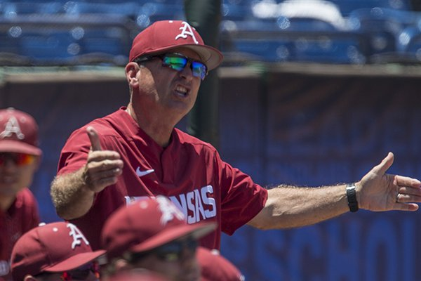 Arkansas coach Dave Van Horn gestures from the dugout during an SEC Tournament game against Ole Miss on Wednesday, May 22, 2019, in Hoover, Ala.