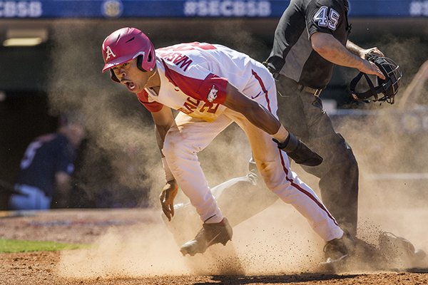 Arkansas pinch runner Curtis Washington reacts after scoring a run during an SEC Tournament game against Ole Miss on Wednesday, May 22, 2019, in Hoover, Ala.