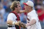 Georgia pitcher Aaron Schunk (right) and catcher Mason Meadows celebrate following a 3-1 victory over Arkansas during an SEC Tournament game Thursday, May 23, 2019, in Hoover, Ala.