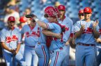 Ole Miss pitcher Parker Caracci and catcher Cooper Johnson embrace after the Rebels defeated Arkansas during the SEC Tournament on Friday, May 24, 2019, in Hoover, Ala.