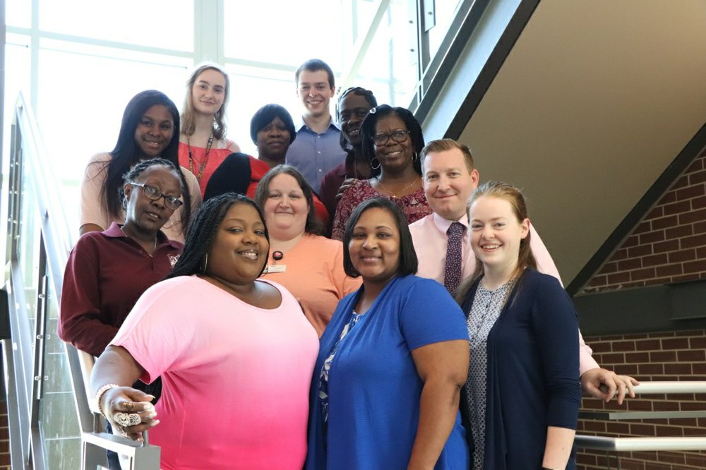 Jonathan Harbour (top) poses with other members of the Student Government Association at SouthArk.
