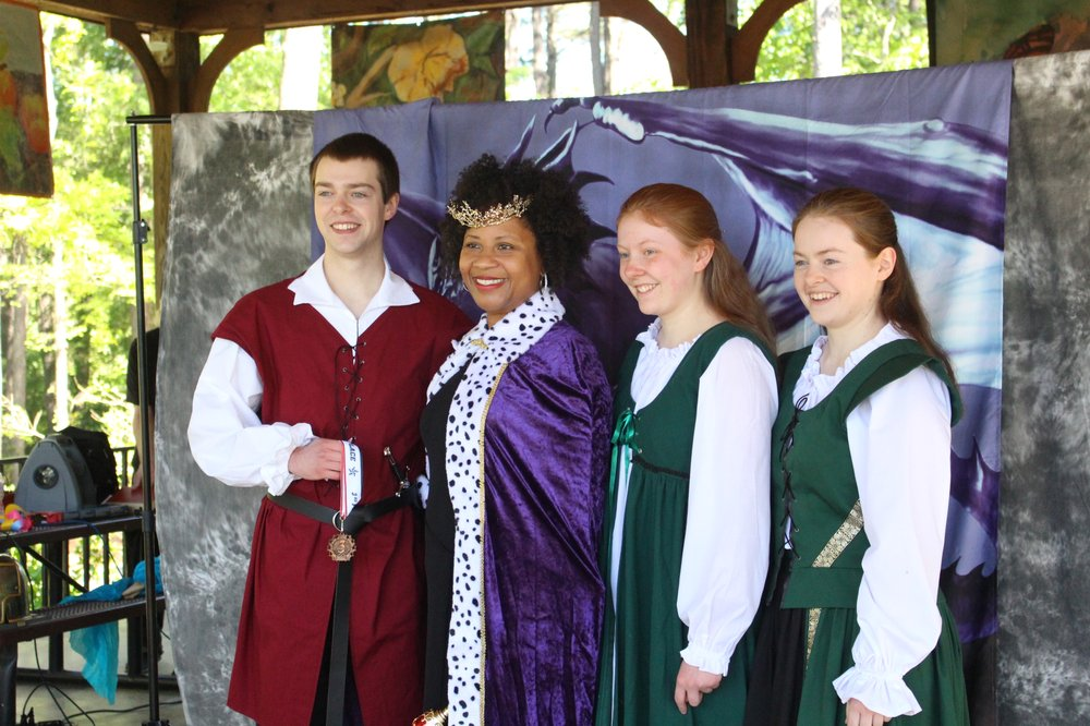 Jonathan Harbour stands with El Dorado Mayor Veronica Smith-Creer and his sisters, Rachel and Hannah, at the Fellowship of the Spring Renaissance Faire, which was held in April by the South Arkansas Community College.