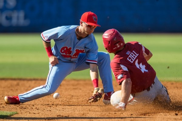 Trevor Ezell, Arkansas second baseman, steals second in the 7th inning after Jacob Adams, Ole Miss second baseman, dropped the ball Friday, May 24, 2019, during the SEC Baseball Tournament at Hoover Metropolitan Stadium in Hoover, Ala.