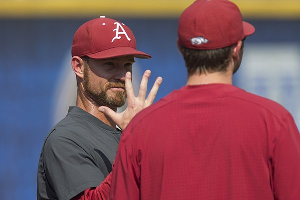Arkansas pitching coach Matt Hobbs talks to pitchers prior to an SEC Tournament game against Georgia on Thursday, May 23, 2019, in Hoover, Ala.