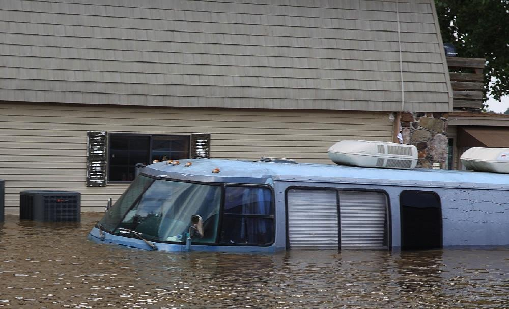 A motor home is covered in floodwaters up to its windshield Wednesday in the Island Harbor Estates neighborhood of Pine Bluff. Most of the homes in the neighborhood were getting at least some flooding Wednesday.