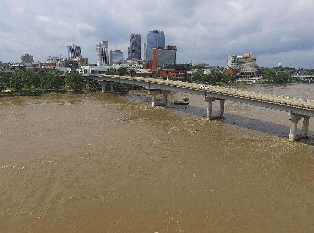 The Arkansas River flows swiftly near downtown Little Rock on Wednesday. The river is expected to crest Monday in Little Rock at 28 feet, considered a major flooding event.