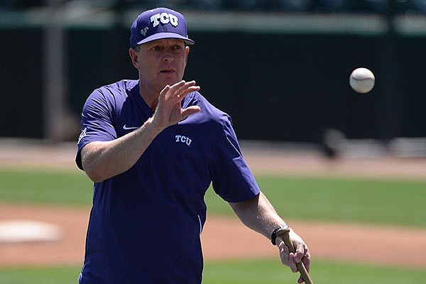 TCU coach Jim Schlossnagle hits Thursday, May 30, 2019, with a fungo during practice and walk-through ahead of the NCAA Baseball Regional at Baum-Walker Stadium in Fayetteville.
