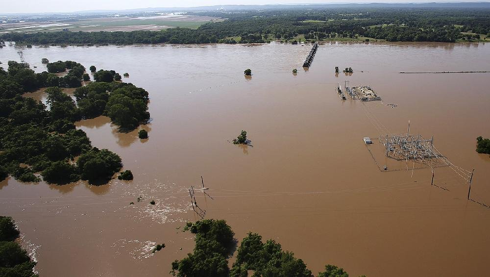 The Arkansas River flows well out of its banks Friday as it swirls past the Arthur V. Ormand Lock and Dam near Morrilton. More photos are available at www.arkansasonline.com/61flooding/