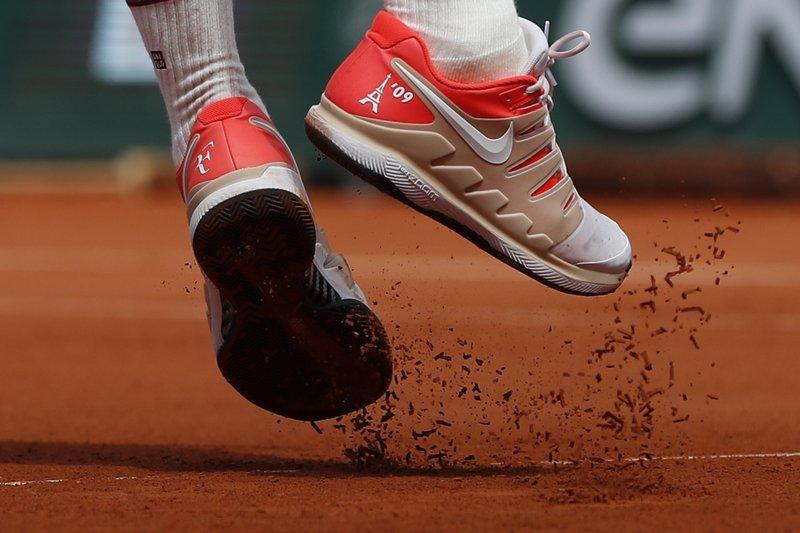 Back on tour in Paris, Federer keeping