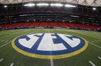 In this Dec. 5, 2014, file photo, SEC logo is displayed on the field ahead of the Southeastern Conference championship football game between Alabama and Missouri in Atlanta. (AP Photo/John Bazemore, File)