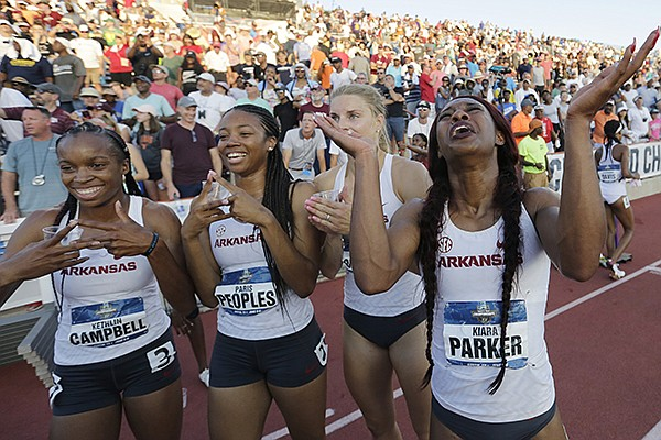 Arkansas' Kethlin Campbell, Paris Peoples, Payton Chadwick, and Kiara Parker, from left, celebrate after Arkansas won the women's team title at the NCAA outdoor track and field championships in Austin, Texas, Saturday, June 8, 2019. (AP Photo/Eric Gay)