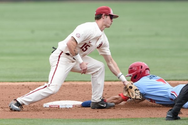 Arkansas Razorbacks infielder Casey Martin (15) attempts to tag Ole Miss infielder Anthony Servideo (3) during game two of the College Baseball Super Regional, Sunday, June 9, 2019 at Baum-Walker Stadium in Fayetteville. Ole Miss forces a game three with a 13-5 win over the Razorbacks