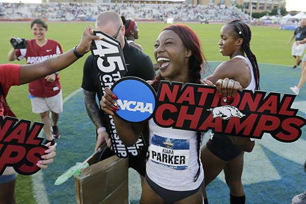 Arkansas' Kiara Parker celebrates with teammates after Arkansas won the women's team title at the NCAA outdoor track and field championships in Austin, Texas, Saturday, June 8, 2019. (AP Photo/Eric Gay)