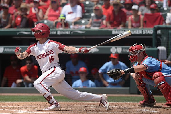Arkansas shortstop Casey Martin hits a single during the first inning of an NCAA super regional game against Ole Miss on Saturday, June 8, 2019, in Fayetteville.