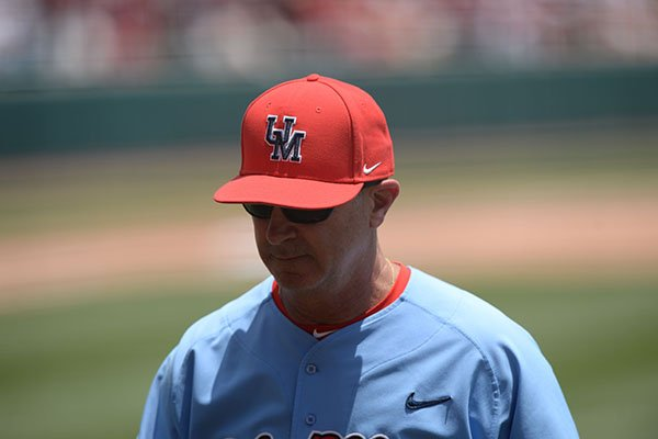 Ole Miss coach Mike Bianco walks toward the dugout during an NCAA super regional game against Arkansas on Saturday, June 8, 2019, in Fayetteville.
