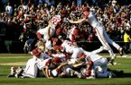 Arkansas players celebrate their win over Ole Miss after Game 3 at an NCAA college baseball super regional Monday, June 10, 2019, in Fayetteville. (AP Photo/Michael Woods)