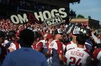 Arkansas players hold up a sign following a 14-1 victory over Ole Miss on Monday, June 10, 2019, during the NCAA Fayetteville Super Regional at Baum-Walker Stadium.
