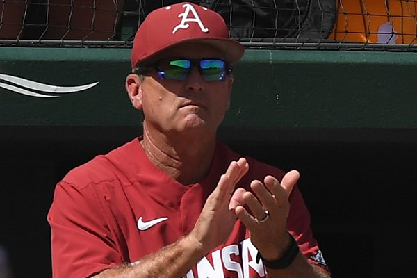 Arkansas coach Dave Van Horn applauds during Game 3 of the NCAA Fayetteville Super Regional at Baum-Walker Stadium on Monday, June 10, 2019, in Fayetteville.