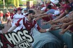 Arkansas catcher Casey Opitz greets fans following the Razorbacks' 14-1 victory over Ole Miss in the NCAA super regional on Monday, June 10, 2019, at Baum-Walker Stadium in Fayetteville.