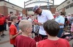 Arkansas pitcher Isaiah Campbell signs autographs for fans outside Baum-Walker Stadium on Wednesday, June 12, 2019, in Fayetteville.