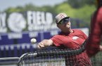 Arkansas coach Dave Van Horn throws batting practice on Sunday, June 16, 2019, at East High School in Bellevue, Neb.
