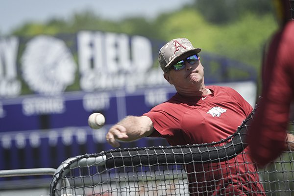 Arkansas coach Dave Van Horn throws batting practice on Sunday, June 16, 2019, at East High School in Bellevue, Neb.