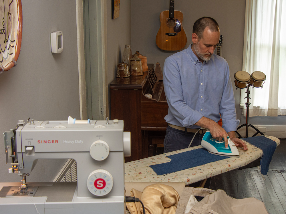 James Matthews irons cloth for use in his quilts. (Arkansas Democrat-Gazette/CARY JENKINS)
