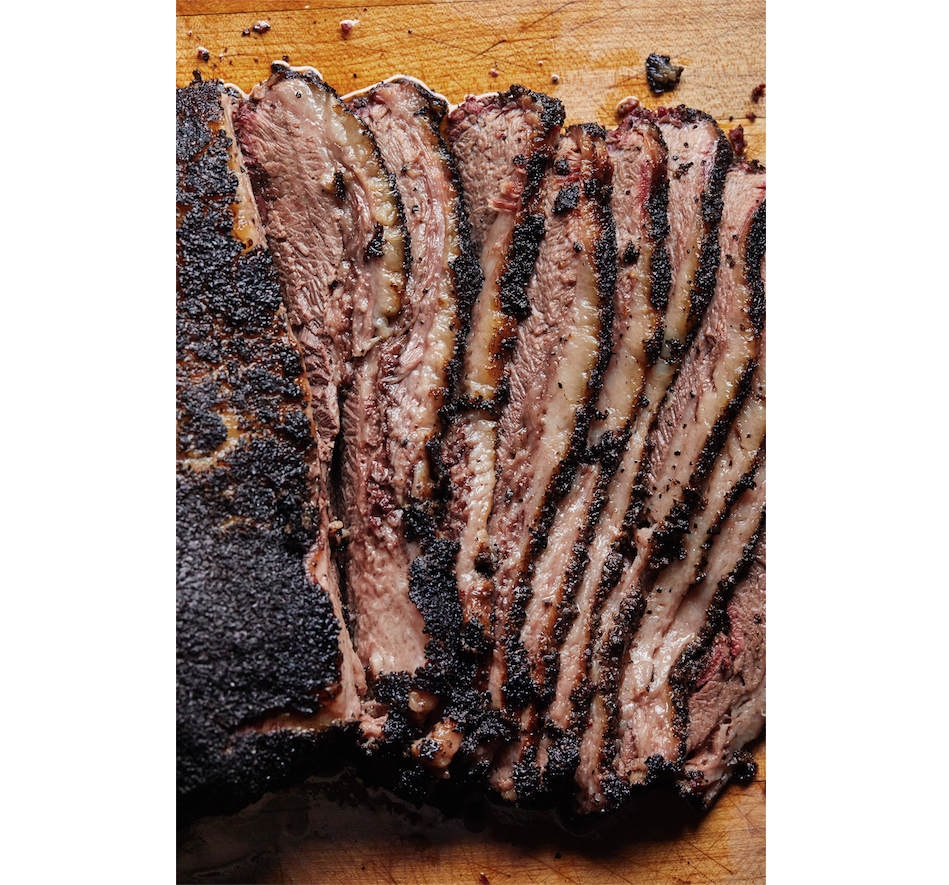 Carving a brisket flat is easy: Simply slice it across the grain to the thickness of a No. 2 pencil. Carving a packer brisket is more challenging because the meat fibers of the point run almost perpendicular to those of the flat. Photo by Tara Donne (The New York Times)