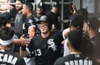 Chicago White Sox's James McCann (33) celebrates in the dugout after he hit a two-run home run during the first inning of a baseball game against the Minnesota Twins on Friday, June 28, 2019, in Chicago. (AP Photo/Matt Marton)